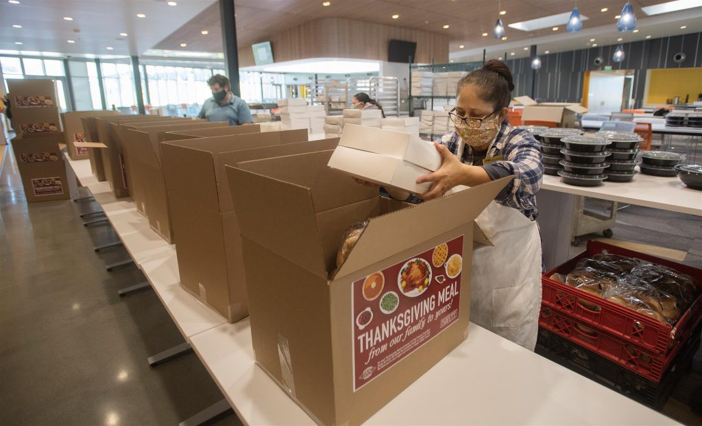 Woman Packaging Thanksgiving Dinners for Customers